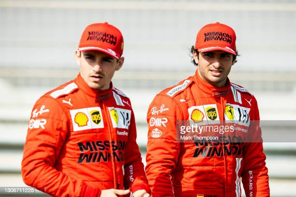 Carlos Sainz of Spain and Ferrari and Charles Leclerc of Monaco and Ferrari look on from the grid during Day One of F1 Testing at Bahrain...