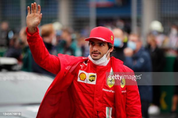 Carlos Sainz of Spain and Ferrari waves to the crowd from the grid during the F1 Grand Prix of Turkey at Intercity Istanbul Park on October 10, 2021...