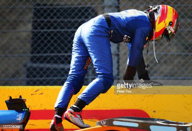Carlos Sainz of Spain and McLaren F1 climbs out of his car after a collision during the F1 Grand Prix of Tuscany at Mugello Circuit on September 13,...
