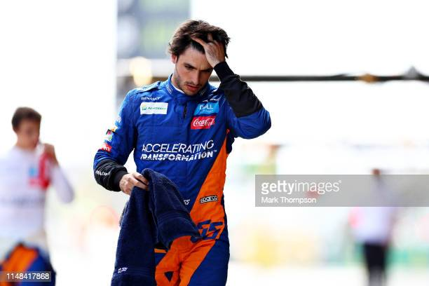 Carlos Sainz of Spain and McLaren F1 looks dejected in the Pitlane during qualifying for the F1 Grand Prix of Spain at Circuit de BarcelonaCatalunya...