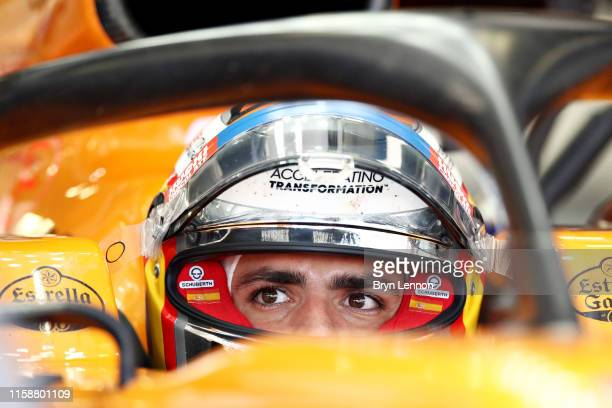 Carlos Sainz of Spain and McLaren F1 prepares to drive in the garage during practice for the F1 Grand Prix of Austria at Red Bull Ring on June 28,...