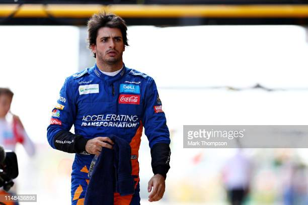 Carlos Sainz of Spain and McLaren F1 walks in the Pitlane during qualifying for the F1 Grand Prix of Spain at Circuit de BarcelonaCatalunya on May 11...