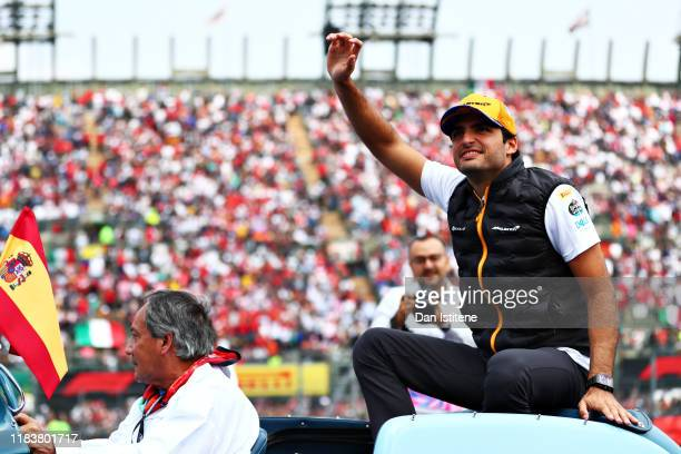 Carlos Sainz of Spain and McLaren F1 waves to the crowd on the drivers parade before the F1 Grand Prix of Mexico at Autodromo Hermanos Rodriguez on...