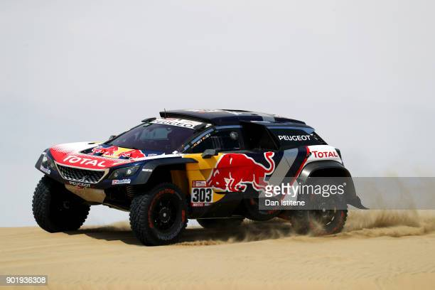 Carlos Sainz of Spain and Peugeot Total drives with codriver Lucas Cruz of Spain in the 3008 DKR Peugeot car in the Classe T14 2 Roues Motrices...