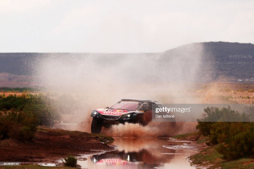 Carlos Sainz of Spain and Peugeot Total drives with co-driver Lucas Cruz of Spain in the 3008 DKR Peugeot car in the Classe : T1.4 2 Roues Motrices, Diesel during stage seven of the 2018 Dakar Rally between La Paz and Uyuni on January 13, 2018 in UNSPECIFIED, Bolivia.