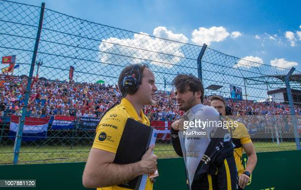 Carlos Sainz of Spain and Renault F1 Team driver talks on grid before the race at Hungarian Rolex Formula 1 Grand Prix on Jul 29 2018 in Mogyoród...