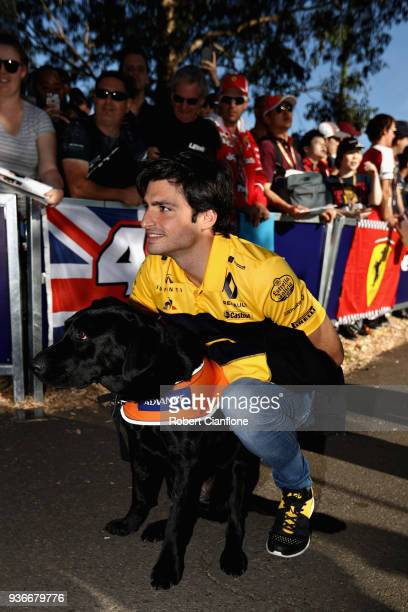 Carlos Sainz of Spain and Renault Sport F1 arrives at the circuit and poses for a photo before practice for the Australian Formula One Grand Prix at...