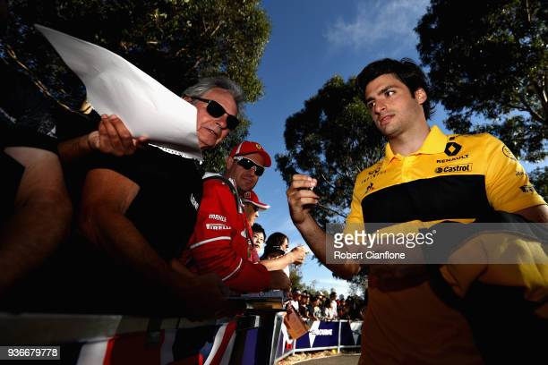 Carlos Sainz of Spain and Renault Sport F1 arrives at the circuit and signs autographs for fans before practice for the Australian Formula One Grand...
