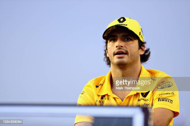 Carlos Sainz of Spain and Renault Sport F1 looks on on the drivers parade before the Formula One Grand Prix of Singapore at Marina Bay Street Circuit...