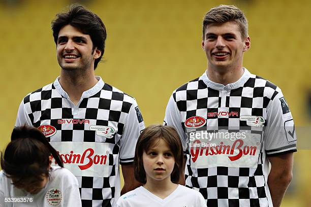 Carlos Sainz of Spain and Scuderia Toro Rosso and Max Verstappen of Netherlands and Red Bull Racing line up for the match during the 24th World Stars...