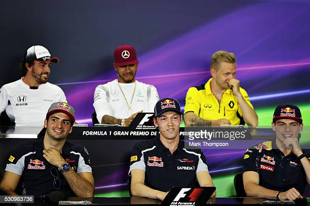 Carlos Sainz of Spain and Scuderia Toro Rosso Daniil Kvyat of Russia and Scuderia Toro Rosso and Max Verstappen of Netherlands and Red Bull Racing...