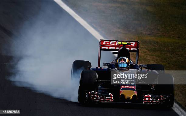 Carlos Sainz of Spain and Scuderia Toro Rosso locks up during qualifying for the Formula One Grand Prix of Hungary at Hungaroring on July 25 2015 in...