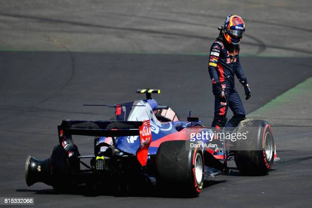 Carlos Sainz of Spain and Scuderia Toro Rosso looks at is car after retiring during the Formula One Grand Prix of Great Britain at Silverstone on...