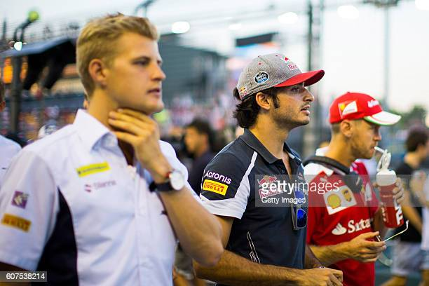 Carlos Sainz of Spain and Scuderia Toro Rosso on the drivers parade before the Formula One Grand Prix of Singapore at Marina Bay Street Circuit on...