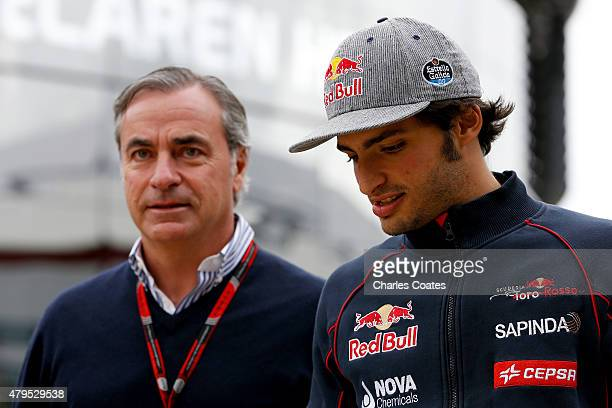 Carlos Sainz of Spain and Scuderia Toro Rosso speaks with his father Carlos Sainz as they arrive in the paddock for the Formula One Grand Prix of...