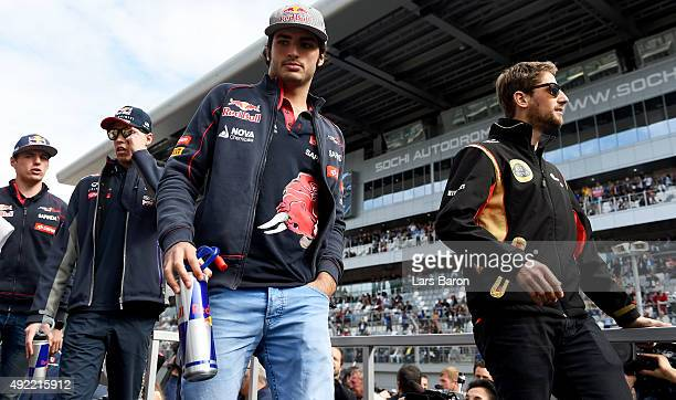 Carlos Sainz of Spain and Scuderia Toro Rosso takes part in the drivers' parade before the Formula One Grand Prix of Russia at Sochi Autodrom on...