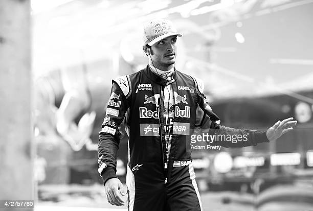 Carlos Sainz of Spain and Scuderia Toro Rosso waves to the fans as he walks to the garage for final practice for the Spanish Formula One Grand Prix...