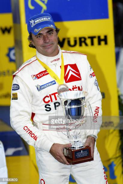 Carlos Sainz of Spain and the Citroen Xsara WRC team is seen on the podium after Leg Three of the 2004 WRC Rally Catalunya Rally de Espana on October...