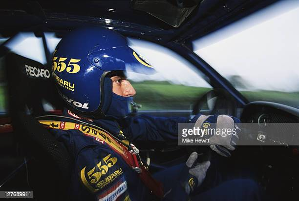 Carlos Sainz of Spain drives the 555 Subaru World Rally Team Subaru Impreza 555 during a preview for the FIA World Rally Championship Network Q RAC...