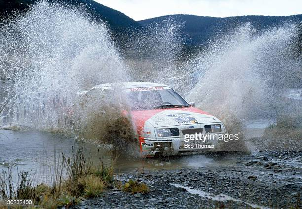 Carlos Sainz of Spain driving a Ford Fiesta Cosworth through the water splash at Myherin in midWales during the Lombard RAC Rally circa 1987