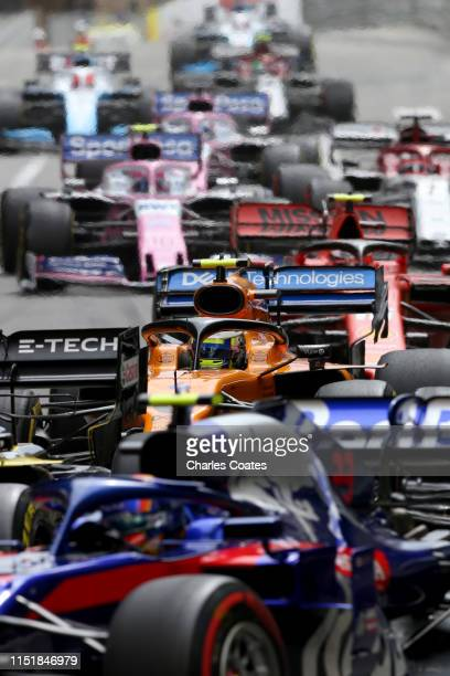 Carlos Sainz of Spain driving the McLaren F1 Team MCL34 Renault is seen among a group of cars during the F1 Grand Prix of Monaco at Circuit de Monaco...