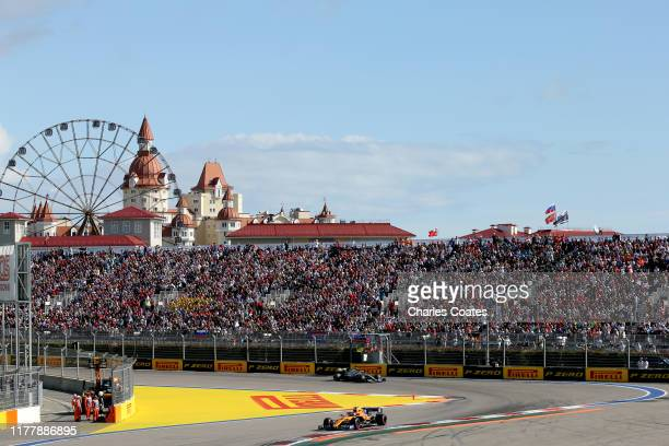 Carlos Sainz of Spain driving the McLaren F1 Team MCL34 Renault leads Valtteri Bottas driving the Mercedes AMG Petronas F1 Team Mercedes W10 on track...