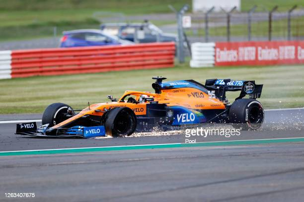 Carlos Sainz of Spain driving the McLaren F1 Team MCL35 Renault on track with a punctured tyre during the F1 Grand Prix of Great Britain at...