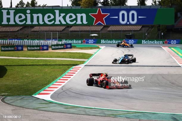 Carlos Sainz of Spain driving the Scuderia Ferrari SF21, Esteban Ocon of France driving the Alpine A521 Renault and Lando Norris of Great Britain...