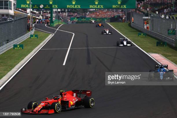 Carlos Sainz of Spain driving the Scuderia Ferrari SF21 leads Fernando Alonso of Spain driving the Alpine A521 Renault during the F1 Grand Prix of...