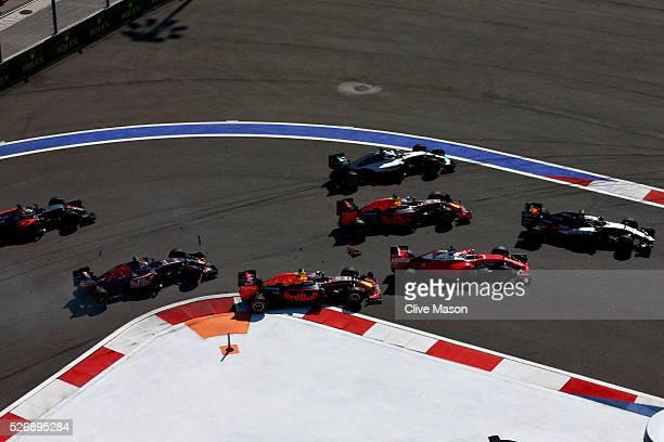 Carlos Sainz of Spain driving the Scuderia Toro Rosso STR11 Ferrari 060/5 turbo Daniil Kvyat of Russia driving the Red Bull Racing Red BullTAG Heuer...