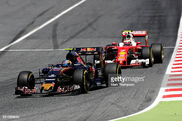 Carlos Sainz of Spain driving the Scuderia Toro Rosso STR11 Ferrari 060/5 turbo leads Kimi Raikkonen of Finland driving the Scuderia Ferrari SF16H...