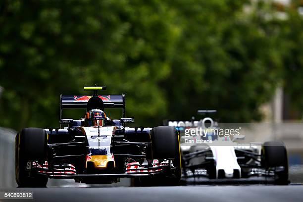 Carlos Sainz of Spain driving the Scuderia Toro Rosso STR11 Ferrari 060/5 turbo ahead of Felipe Massa of Brazil driving the Williams Martini Racing...