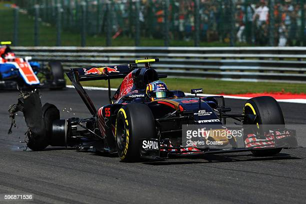 Carlos Sainz of Spain driving the Scuderia Toro Rosso STR11 Ferrari 060/5 turbo with a punctured rear tyre during the Formula One Grand Prix of...