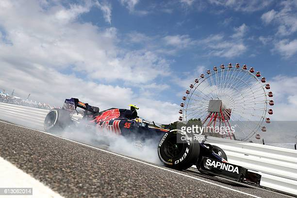 Carlos Sainz of Spain driving the Scuderia Toro Rosso STR11 Ferrari 060/5 turbo locks a wheel as he comes into the pits during practice for the...