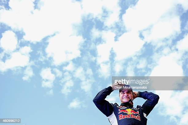 Carlos Sainz of Spain for Team Peugeot Total in the Buggy 2008 DKR Peugeot waves to the fans after his drive on the streets from the Obelisk of...