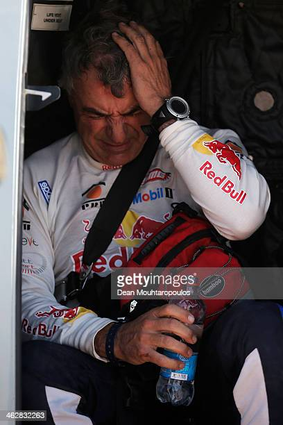 Carlos Sainz of Spain for the SMG Buggy and Red Bull Rally Team is taken away by medical staff in a military helicopter after his crash in stage 10...