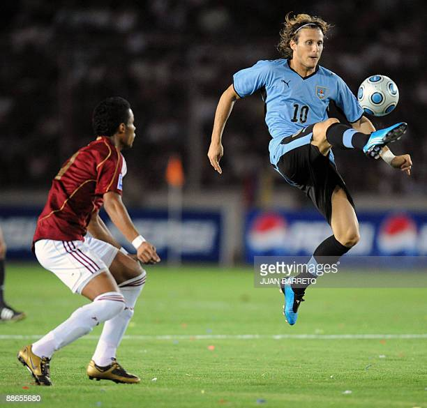 Carlos Salazar of Venezuela vies for the ball with Diego Forlan of Uruguay during their FIFA World Cup South Africa-2010 qualifier football match at...