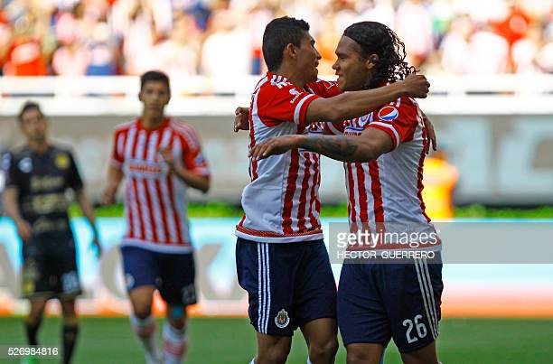 Carlos Salcedo and Carlos Pena of Guadalajara celebrate after scoring against Dorados during their Mexican Clausura 2016 tournament football match at...