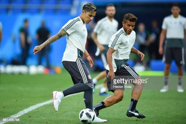 Carlos Salcedo and Jonathan dos Santos of Mexico go for the ball during a training session ahead of the match against Korea as part of FIFA World Cup...