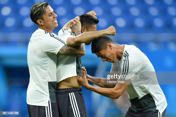 Carlos Salcedo Marco Fabian and Hector Moreno of Mexico have fun during a training session ahead of the match against Korea as part of FIFA World Cup...