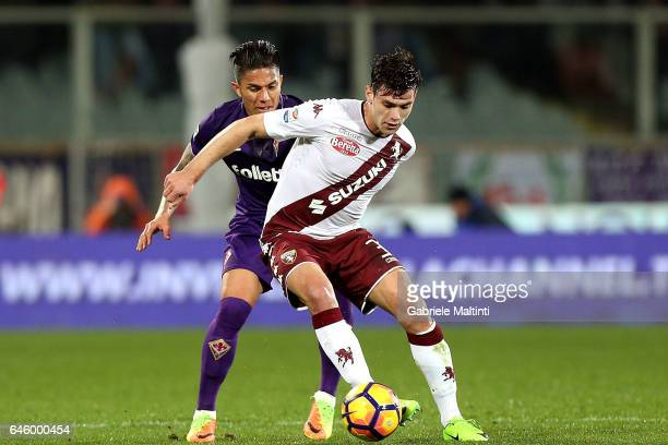 Carlos Salcedo of ACF Fiorentina battles for the ball with Lucas Boye' of FC Torino during the Serie A match between ACF Fiorentina and FC Torino at...
