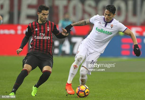 Carlos Salcedo of ACF Fiorentina competes for the ball with Fernandez Suso of AC Milan during the Serie A match between AC Milan and ACF Fiorentina...