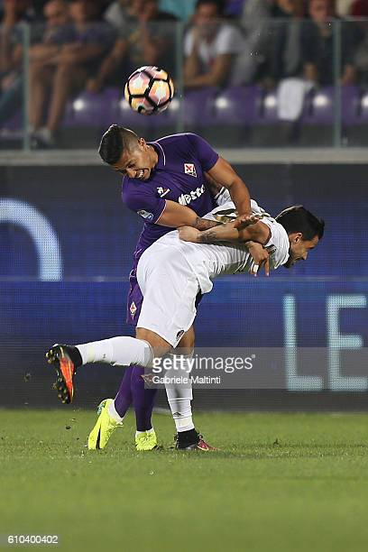 Carlos Salcedo of ACF Fiorentina fights for the ball with Carlos Bacca of AC Milan during the Serie A match between ACF Fiorentina and AC Milan at...