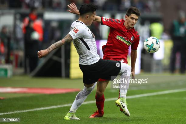 Carlos Salcedo of Eintracht Frankfurt fights for the ball with Bartosz Kapustka of SC Freiburg during the Bundesliga match between Eintracht...
