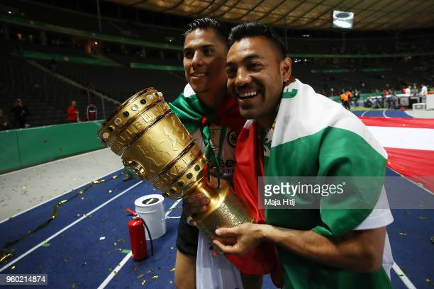 Carlos Salcedo of Frankfurt and Marco Fabian of Frankfurt pose with the trophy after the DFB Cup final between Bayern Muenchen and Eintracht...