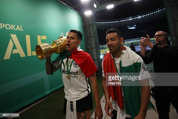 Carlos Salcedo of Frankfurt and Marco Fabian of Frankfurt walk out of the arena with the trophy after the DFB Cup final between Bayern Muenchen and...