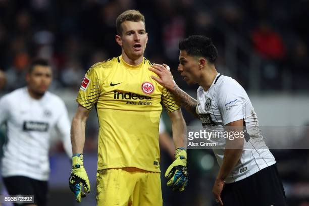 Carlos Salcedo of Frankfurt congratulates Lukas Hradecky of Frankfurt after a good safe during the Bundesliga match between Eintracht Frankfurt and...