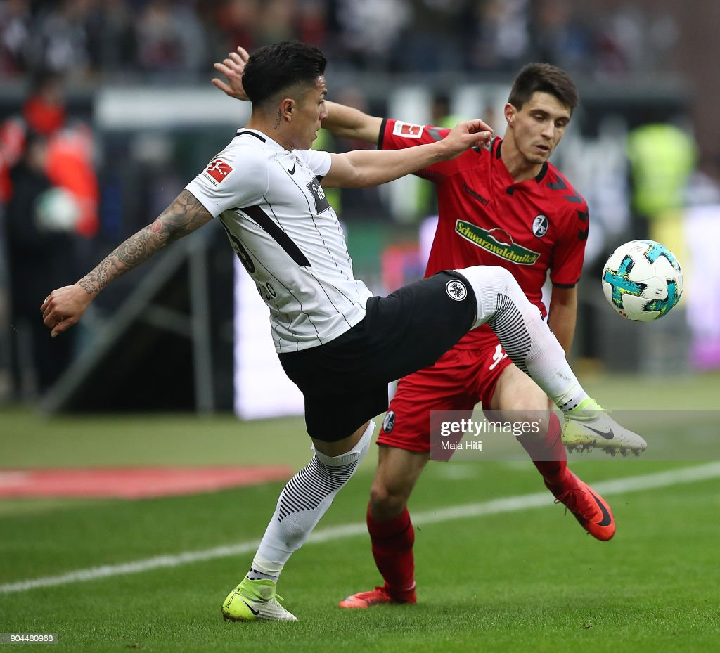 Carlos Salcedo of Frankfurt (l) fights for the ball with Bartosz Kapustka of Freiburg during the Bundesliga match between Eintracht Frankfurt and Sport-Club Freiburg at Commerzbank-Arena on January 13, 2018 in Frankfurt am Main, Germany.