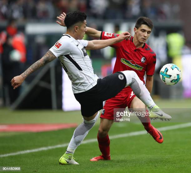 Carlos Salcedo of Frankfurt fights for the ball with Bartosz Kapustka of Freiburg during the Bundesliga match between Eintracht Frankfurt and...