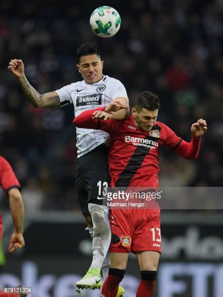 Carlos Salcedo of Frankfurt jumps for a header with Lucas Alario of Leverkusen during the Bundesliga match between Eintracht Frankfurt and Bayer 04...